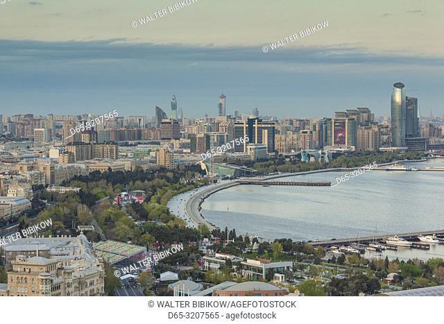 Azerbaijan, Baku, high angle view of city skyline from the west, dusk