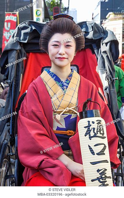 Japan, Honshu, Tokyo, Asakusa, Jidai Matsuri festival, participant in traditional kimono