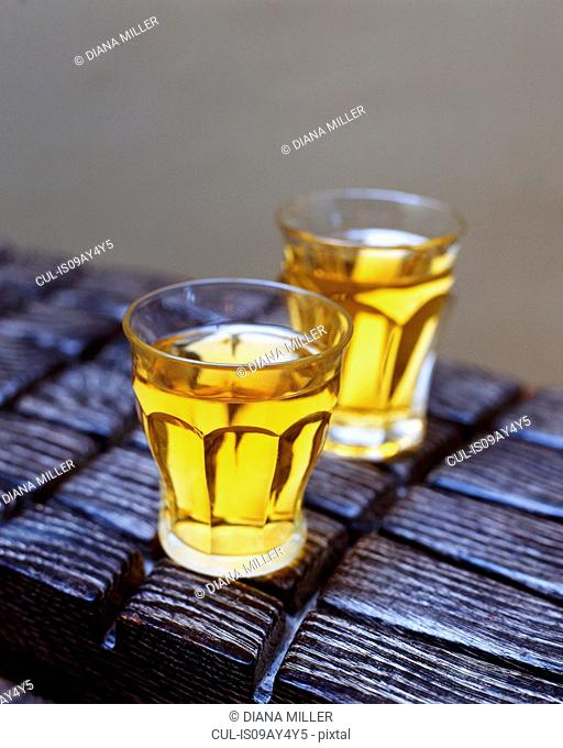 Drinks, cider in glasses on wooden table