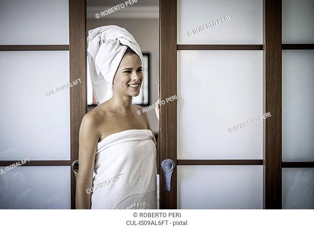Young woman with towel on head