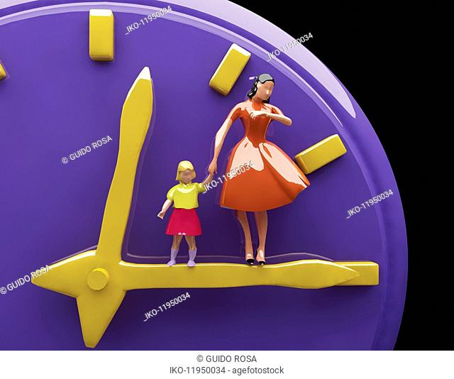 Mother and daughter standing on clock hands checking time