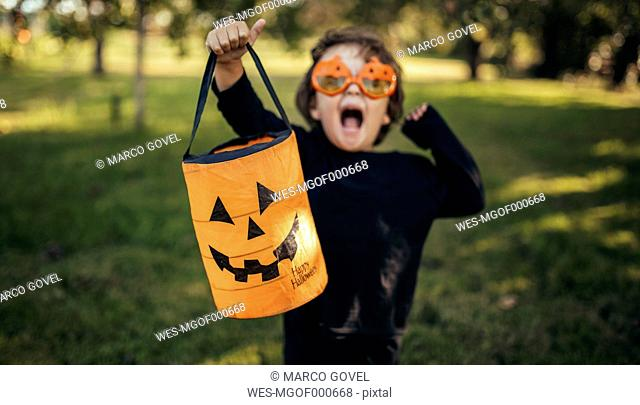 Masquerade little girl holding halloween lantern