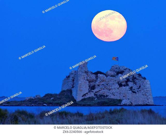Full Moon at St. John tower ruins. Alfacs Bay. Ebro River Delta Natural Park, Tarragona province, Catalonia, Spain