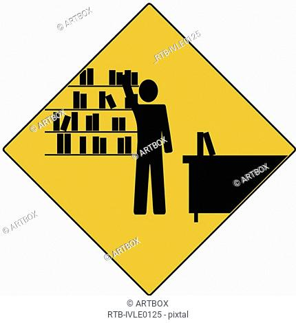 Businessman standing near a bookshelf and reaching out for a file