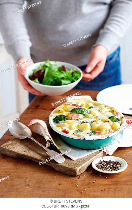 Dish of baked ham and leek gnocchi