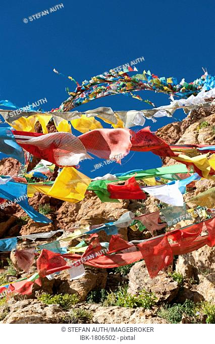 Colorful prayer flags fluttering in the wind, Tibetan Buddhism, Choku Gompa monastery, pilgrims' path, Kora path around Mount Kailash, Gang Rinpoche mountain