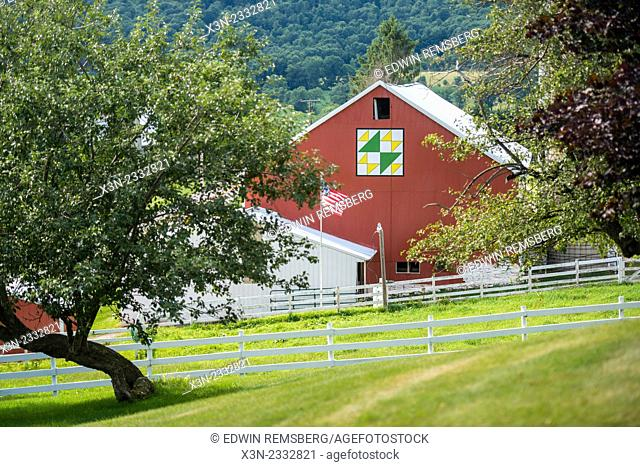 Red barn with painted quilt pattern on a farm in Garrett County, Maryland, USA