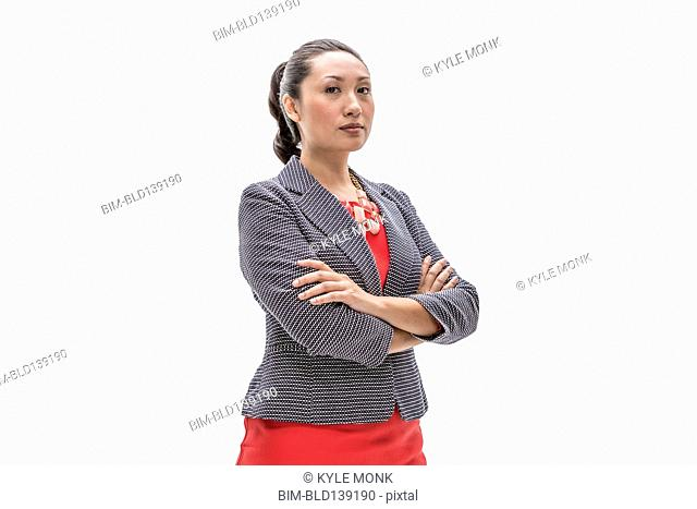 Pacific Islander businesswoman standing with arms crossed