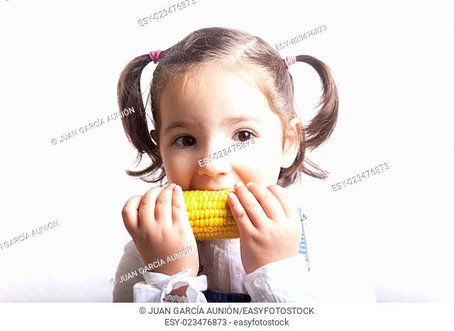 Portrait of happy girl biting a corncob. Isolated over white background