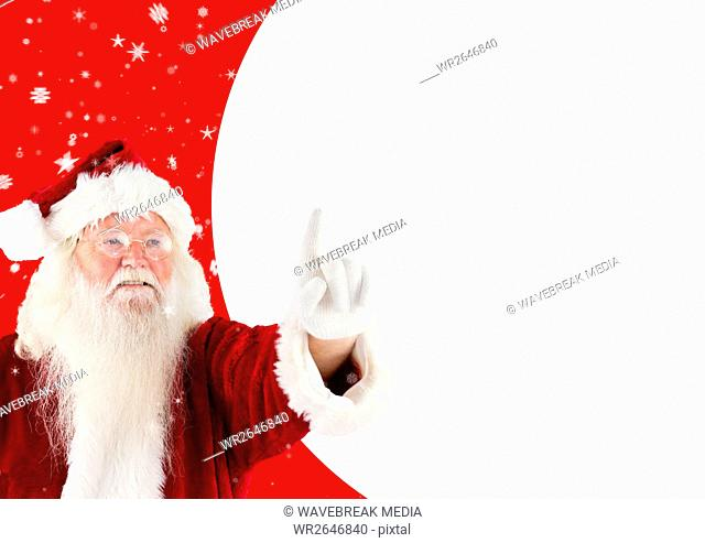 Happy santa claus pointing