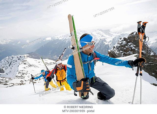 Climbing deep snow skiing mountains cross-county