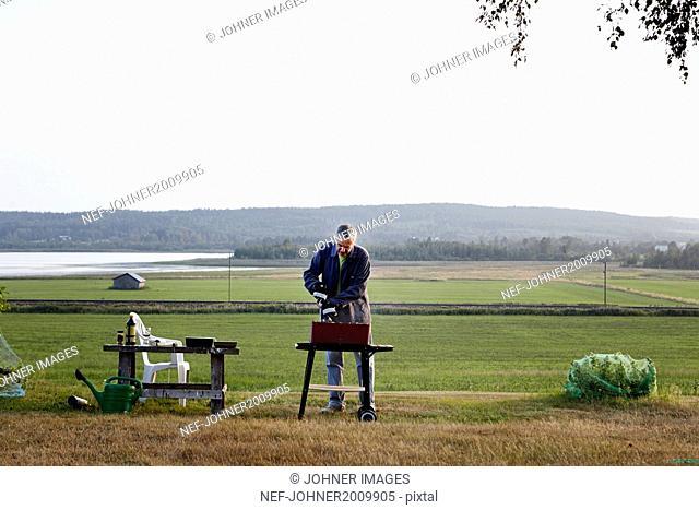 Man preparing barbecue