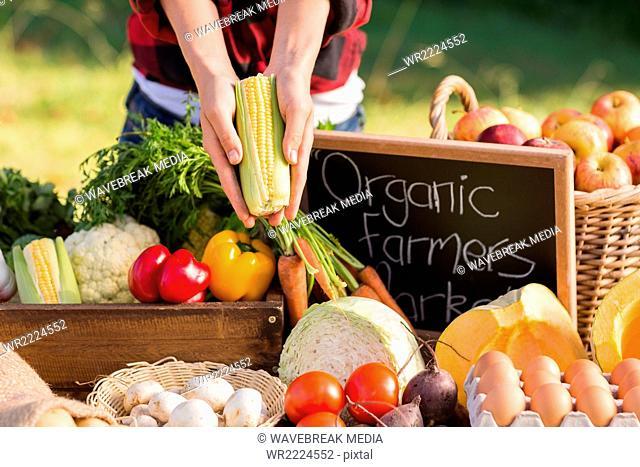 Woman selling organic vegetables