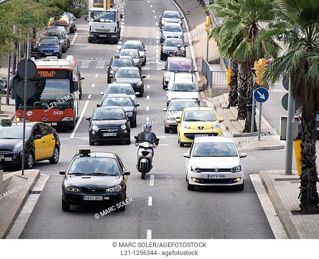 Traffic jam. Cars, bus and motorcycles in Travessera de Dalt. Gràcia quarter, Barcelona, Catalonia, Spain