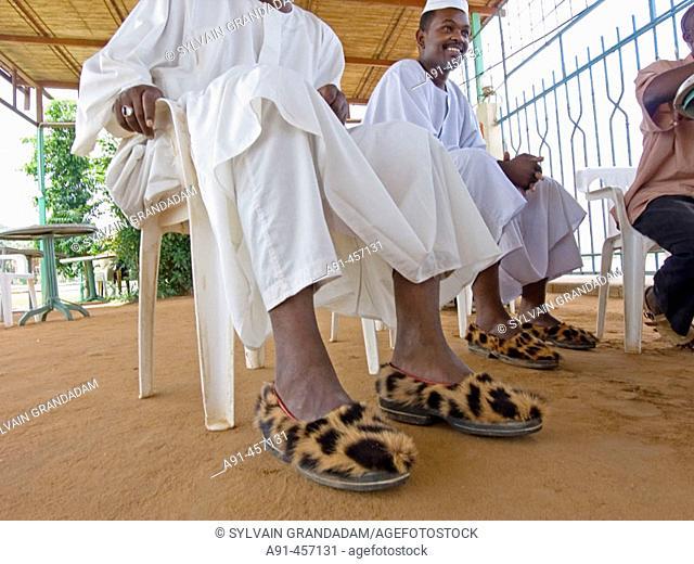 Men wearing costly leopard slippers, Khartoum. Upper Nubia, Sudan