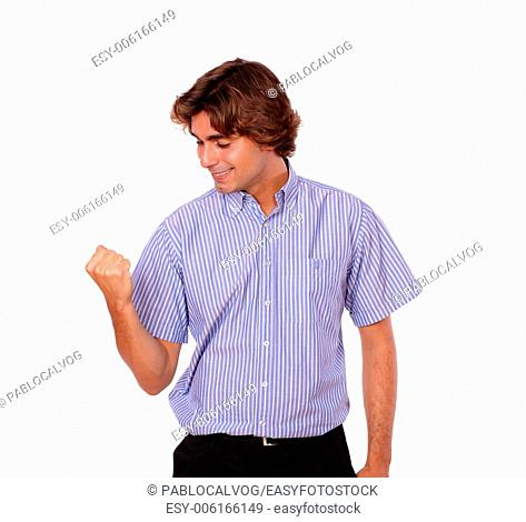 Portrait of a young man celebrating a victory with positive attitude on isolated background