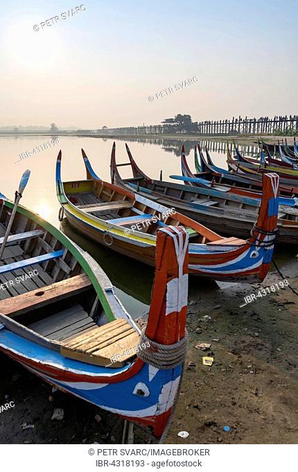 Fishing boats at the shore of Taungthaman Lake near the U Bein Bridge, Amarapura near Mandalay, Myanmar