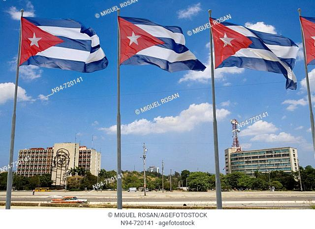 Cuban flags and Ministry of the Interior (Ministerio del Interior) building with Che Guevara bronze wire sculpture in background, Havana. Cuba