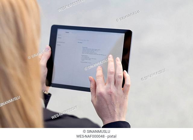 Businesswoman using tablet, close-up