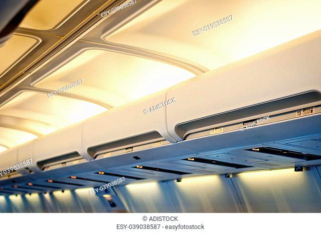Airplane interior detail. Luggage shelf row