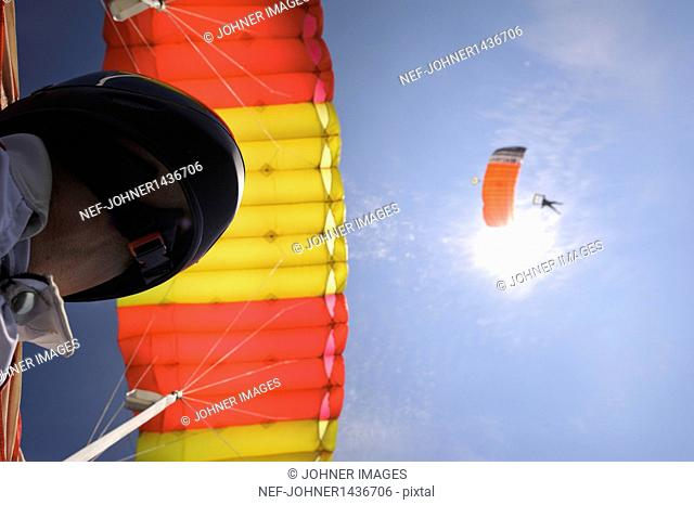 Paragliders, low angle view