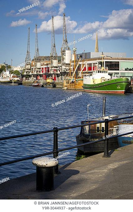Classic and historic ships line the wharf of Bristols docks, Bristol, England