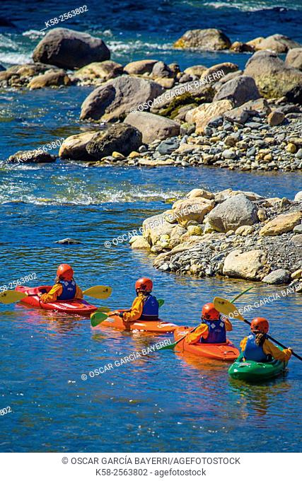 Children kayaking on the river Noguera Pallaresa passing through Sort in Lleida