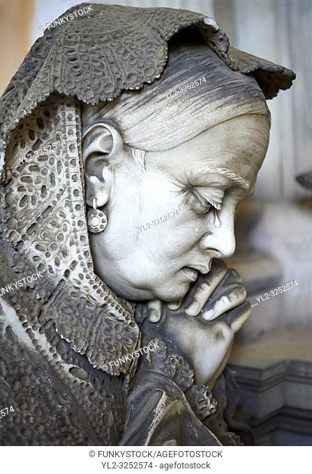Picture and image of the stone sculpture of a mouring women in the Bourgeois Realistic style. Badaracco Tomb sculpted by G Moreno 1878