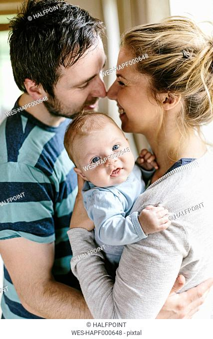 Mother and father with baby boy