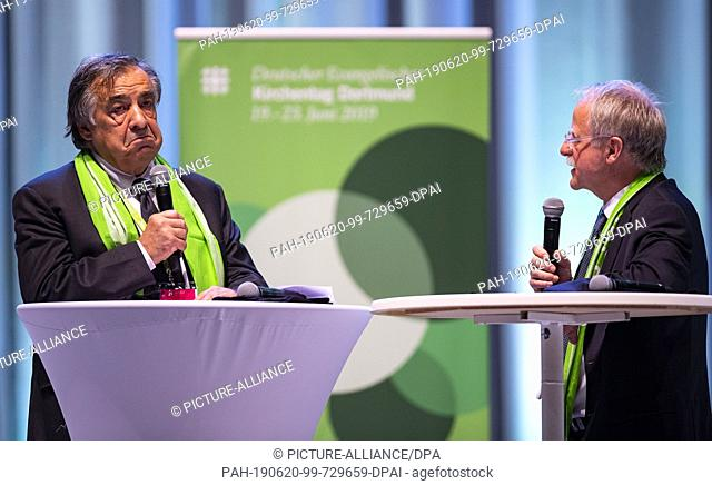 20 June 2019, North Rhine-Westphalia, Dortmund: Leoluca Orlando (l), Lord Mayor of Palermo, and Hans Leyendecker, journalist and President of the Kirchentag