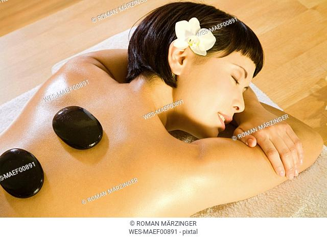 Young woman in spa, receiving lastone therapy