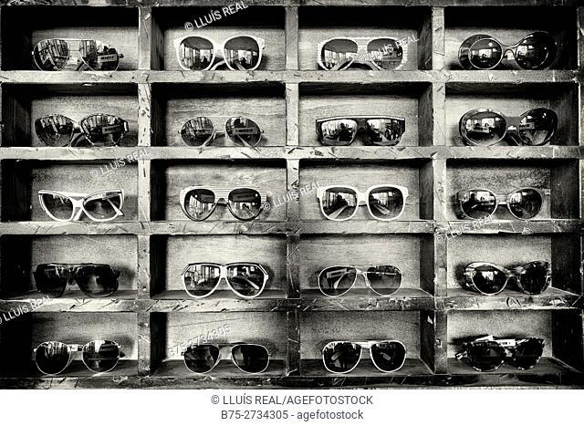 Assorted sunglasses in pigeonholes