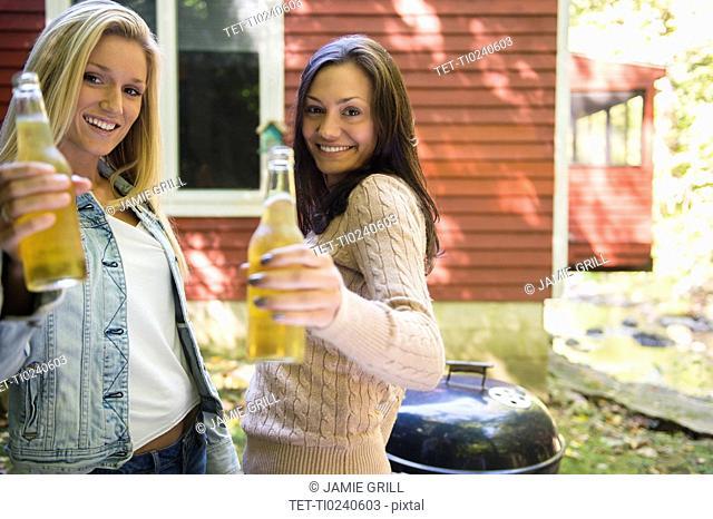 Two women enjoying barbecue
