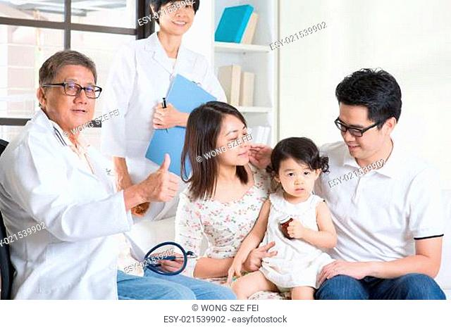 Pediatrician giving a thumb up after examined child. Pediatrician and patient healthcare concept