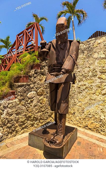 Sculpture representing a man who has in his hand a chandelier in the old walled city of Cartagena de Indias. Bolivar; Colombia