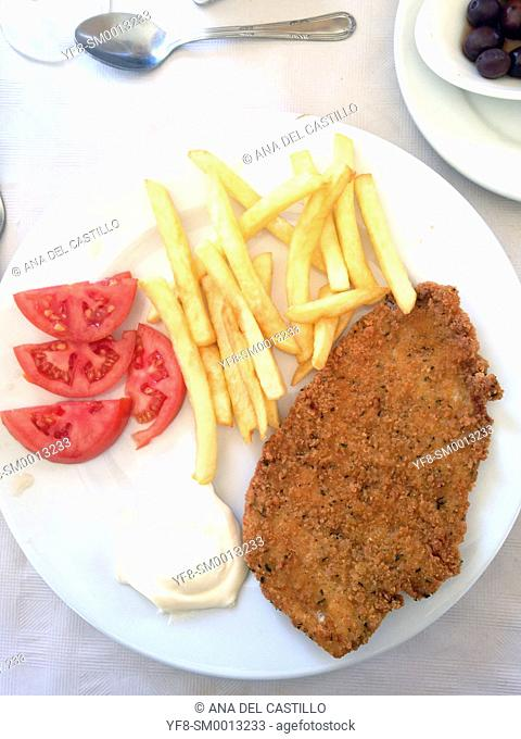 escalope or Schnitzel fresh tomato and fries