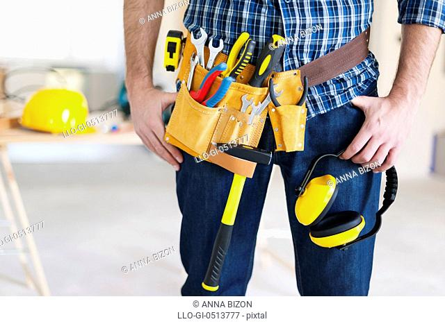 Part of construction worker with tools belt. Pilzno, Poland