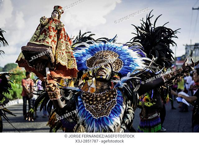 "Participants of the parade during the celebration of Dinagyang in homage to """"The Santo Niño"""", the patron saint of many Philippino cities"