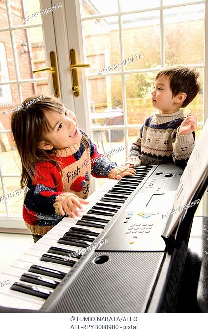 Kids playing piano