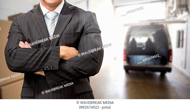 Business man in suit standing with arms crossed