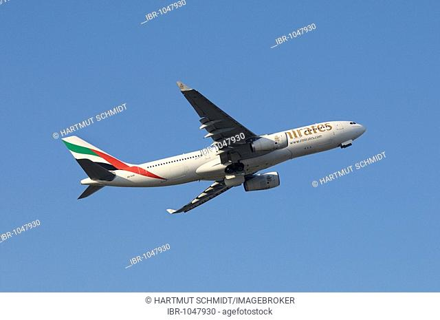 Emirates commercial aircraft Airbus A330-200 during climb flight