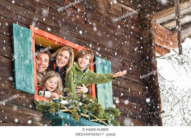Austria, Salzburg, Hüttau, Family in a farmhouse, smiling