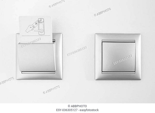 Hotel open room card system with light switch white wall. Horizontal
