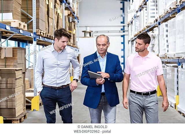 Business people meeting in company storehouse