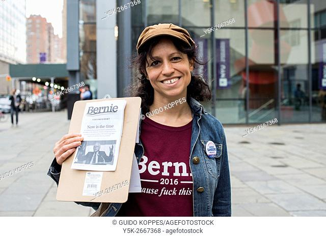 New York City, USA. Young Hispanic woman promoting the Bernie Sanders campain for President of the United States