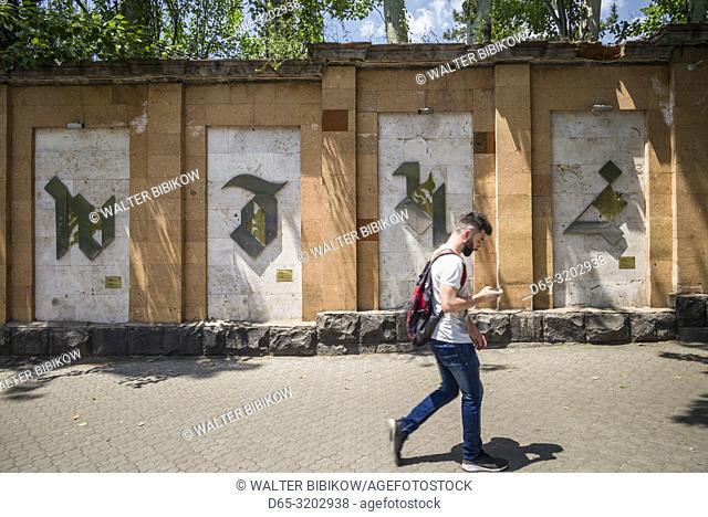 Armenia, Yerevan, Armenian Alphabet Wall by the Matenadaran library, with people, NR