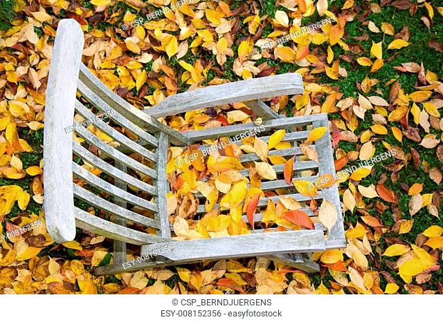 a wooden deckchair covere