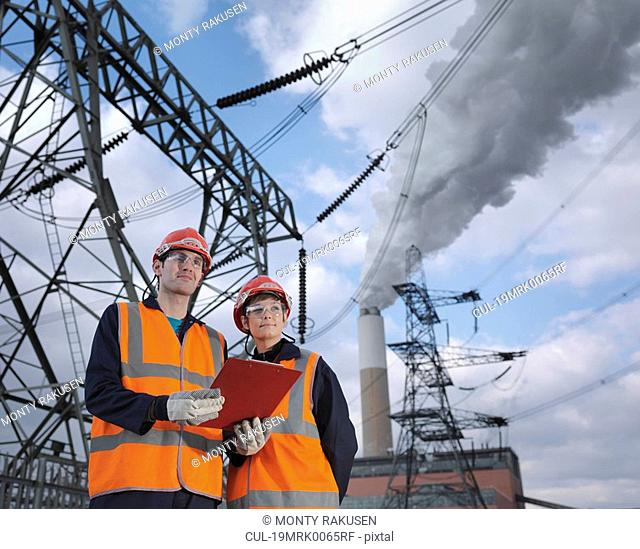Male & Female Workers At Power Station