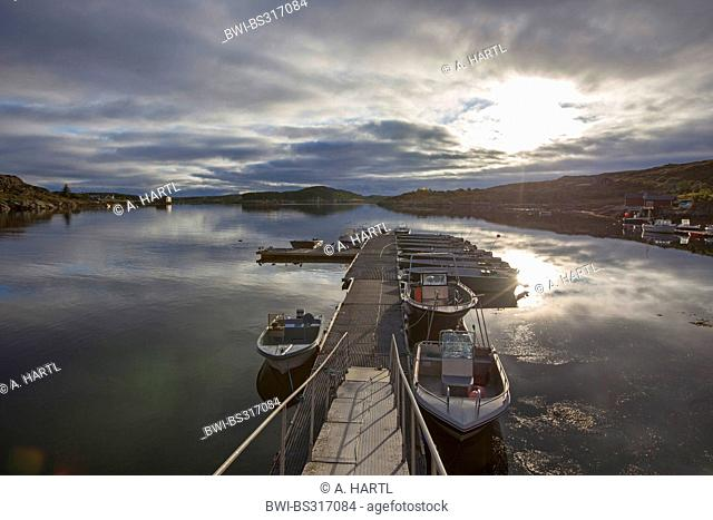 landing stage with motorboats at sunrise, Norway, Hitra