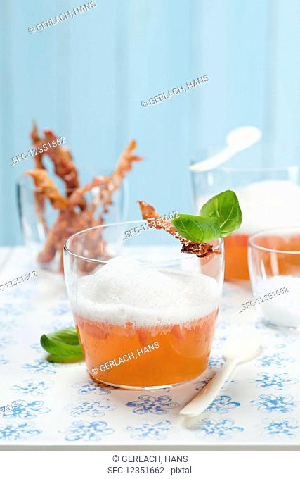 Cold basil and tomato essence with Ibérico ham espuma (Spain)
